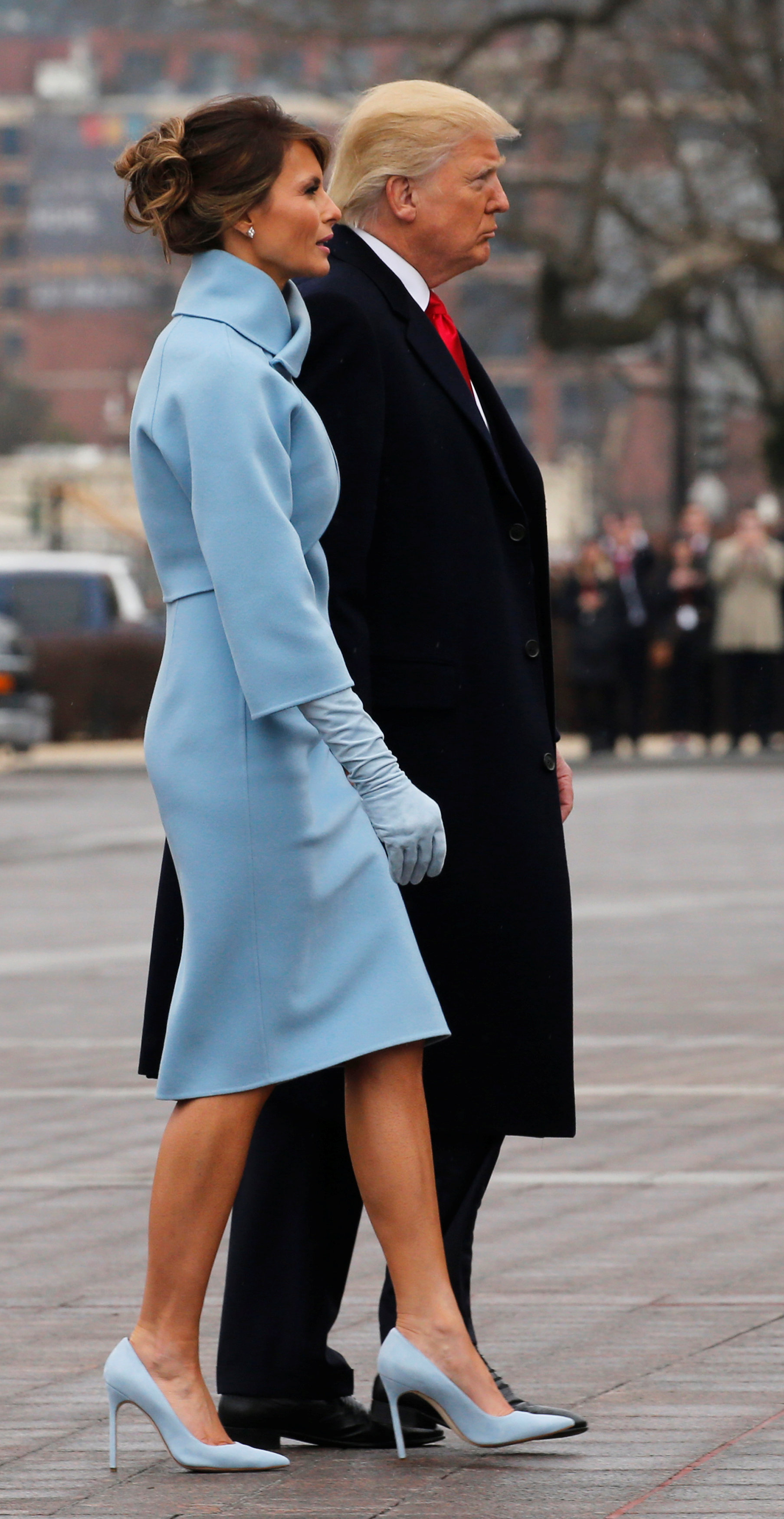 U.S. President Donald Trump and first lady Melania Trump walk after seeing off former U.S. President Barack Obama and his wife Michelle Obama as they depart following Trump's inauguration at the Capitol in Washington, U.S. January 20, 2017. REUTERS/Jonathan Ernst
