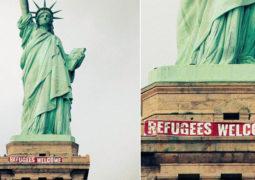 مجهولون يعلقون لافتة مرحباً باللاجئين على تمثال الحرية في وسط نيويورك